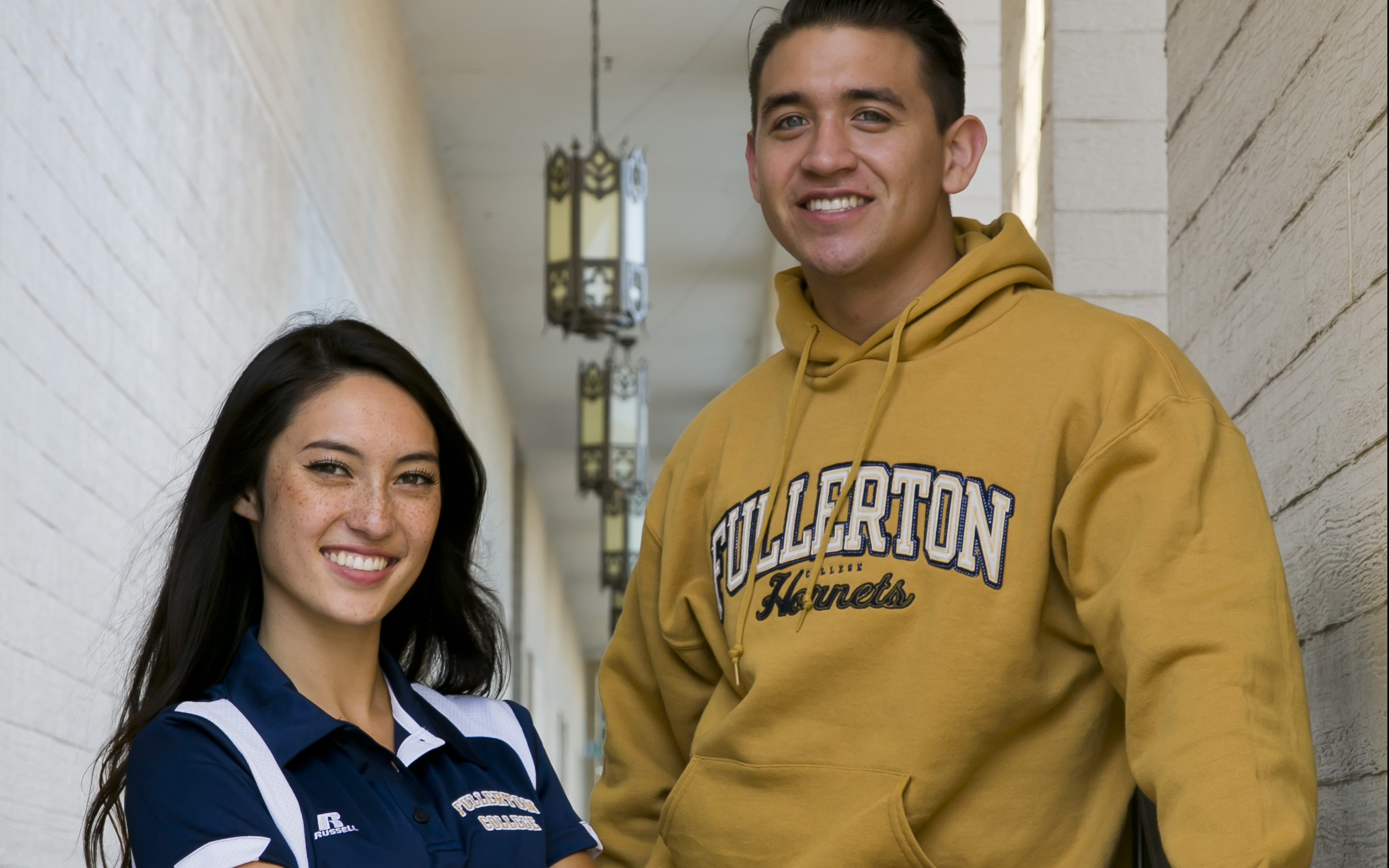 Fullerton College students proudly sporting Hornets gear.