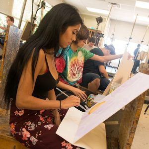 Students paint during a Fullerton College art class.