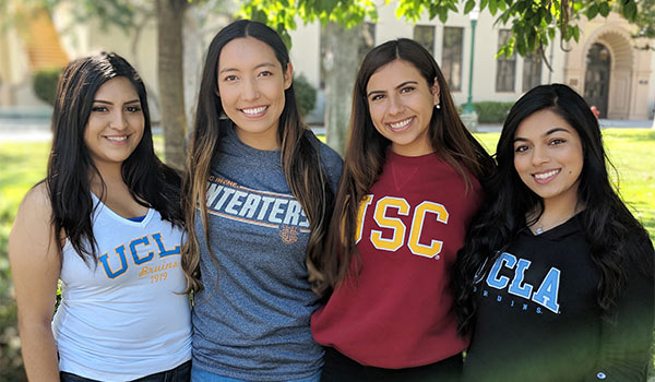 Students with apparel of universities they are transferring to